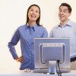 Royalty-Free Stock Photo: Portrait of businesspeople laughing at computer