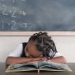 School girl sleeping on book - Stock Photo