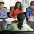 High angle view of four business executives in a meeting — Stock Photo