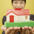 Businesswoman holding house model — Stock Photo
