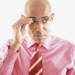 Businessman adjusting glasses — Stock Photo