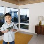 Boy holding toy dinosaur — Stock Photo #13222266