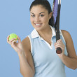 Teen girl posing with tennis racquet - Stock Photo