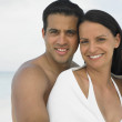 Stock Photo: Couple hugging on the beach