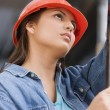 Hispanic female construction worker using a level — Stock Photo