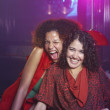 Hispanic women laughing at nightclub — Foto de Stock