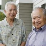 Portrait of two elderly men smiling — Stock Photo #13222300