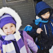 Mother sending children to school in winter — Stock Photo
