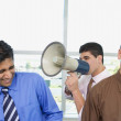 Group of businessmen with megaphone — Stock Photo
