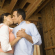 Hispanic couple kissing at construction site — Stock Photo