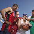 Nerd being harassed on basketball court — Stok fotoğraf