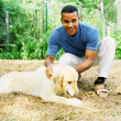 Man petting dog - Stockfoto