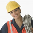 Portrait of female construction worker smiling — Stock Photo #13222398