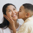 Stock Photo: Indian boy kissing mother's cheek