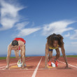 Male track runners prepare to race — Stock Photo