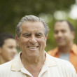 Portrait of senior man smiling — Stock Photo