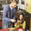 Young Hispanic couple at the dinner table — Stock Photo #13222552