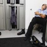 Hispanic male mechanic sleeping in locker room — Stock Photo #13222600