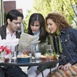Royalty-Free Stock Photo: Hispanic friends looking at street map