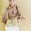 Portrait of Pacific Islander girl holding gift — Stock Photo