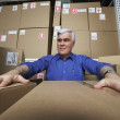 Frustrated businessman in warehouse  — Foto Stock