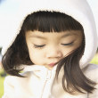 Closeup of young girl in parka — Stock Photo