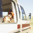 Young girl riding in a recreational vehicle — Stockfoto