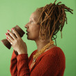 Profile of woman drinking from glass - Stock Photo