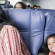 Portrait of young girl on airplane — Stock Photo