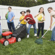 Multi-ethnic children doing yard work — Stockfoto