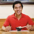 Portrait of Asian man eating rice — Stock Photo #13222875