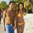 South American couple walking on beach — Stock Photo