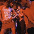 Young dancing together at club — Stock Photo
