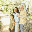 Hispanic grandparents with grandson on nature trail — Stock Photo