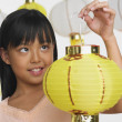 Young Asian girl holding paper lantern — Stock Photo