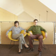 Businesspeople relaxing in office space — Stock Photo
