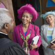 Senior African American women talking to Reverend - Stock Photo