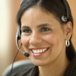 Close up of businesswoman with headset — Stock Photo