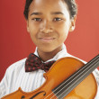 Stock Photo: African boy holding violin