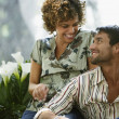 South American couple smiling at each other — Stock Photo