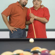 Hispanic grandfather, father and son playing pool - ストック写真