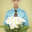 Middle Eastern businessman holding bouquet of flowers - Stok fotoğraf