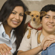 Stock Photo: Hispanic mother and son with small dog