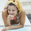 Stock Photo: Young woman eating strawberry