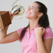 Portrait of excited teenage girl with trophy — Stock Photo