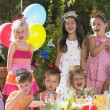 Childs birthday party outdoors — Stock Photo #13223356