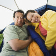 Portrait of couple laying in tent — Stock Photo #13223365