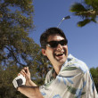 Man swinging golf club outdoors — Stock Photo