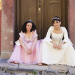 Stock Photo: Hispanic girls wearing Quinceanerdresses