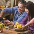 Middle-aged Hispanic couple at dinner party — Stock Photo #13223410